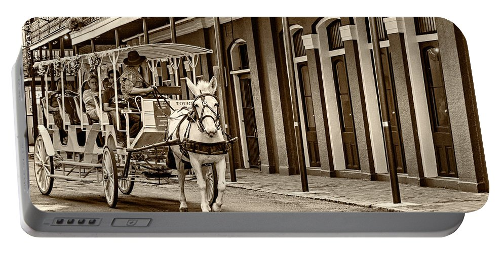 French Quarter Portable Battery Charger featuring the photograph French Quarter Carriage Ride Sepia by Steve Harrington