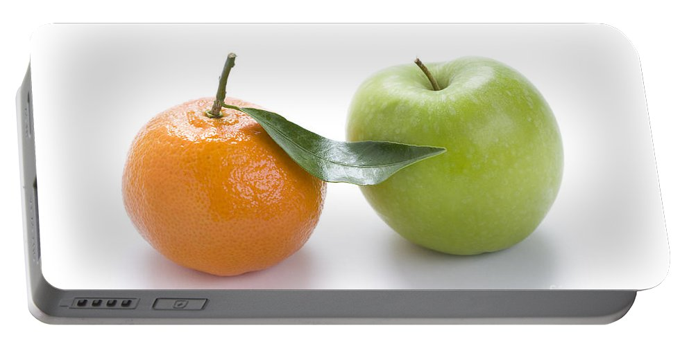 Oranges And Apples Portable Battery Charger featuring the photograph Fresh Apple And Orange On White by Lee Avison