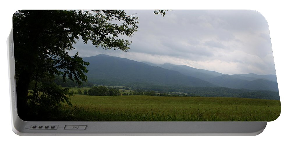 Cades Cove Portable Battery Charger featuring the photograph From The Shadows by Dan McCafferty