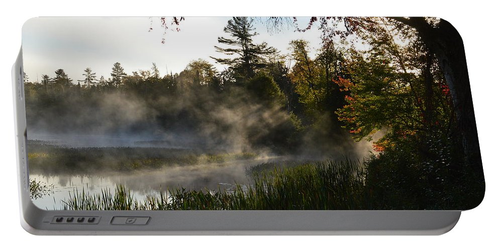 Marsh Portable Battery Charger featuring the photograph Frosty Glow by Thomas Phillips