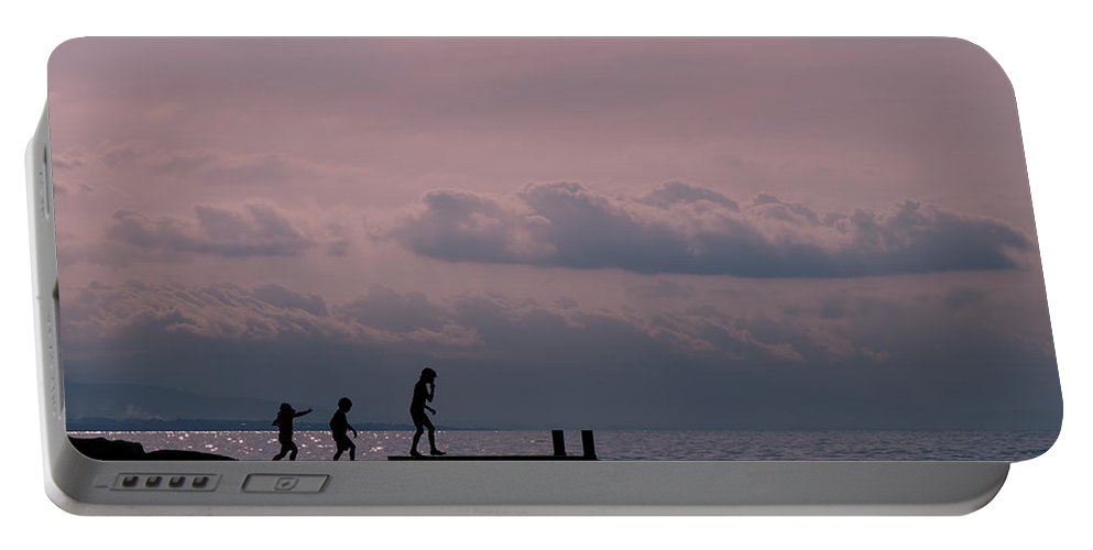 Sunset Portable Battery Charger featuring the photograph Fun At Sunset by Jean-Pierre Ducondi