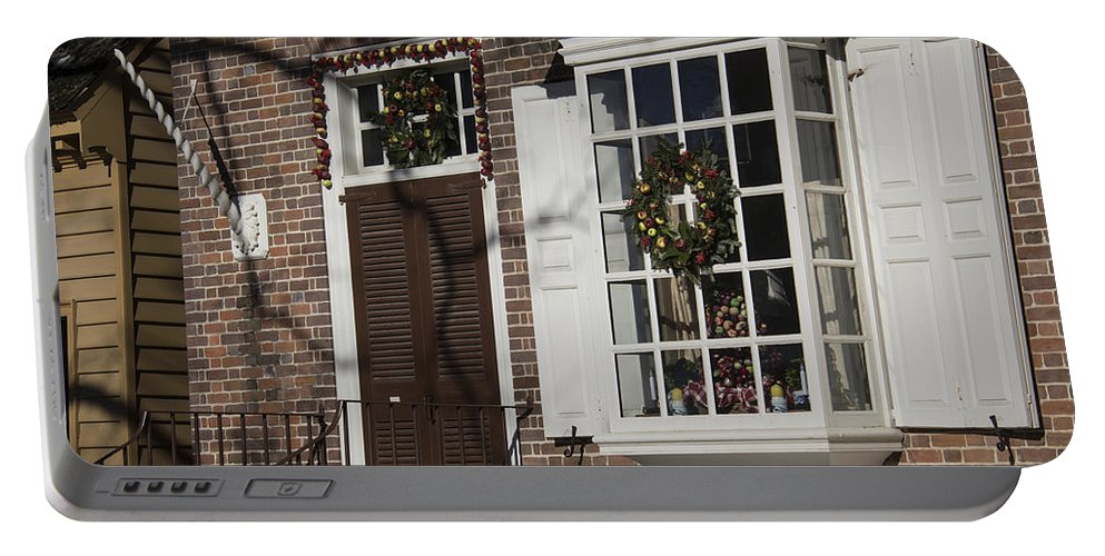 Colonial Williamsburg Portable Battery Charger featuring the photograph Garland And Wreaths by Teresa Mucha