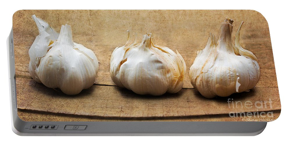 Garlic Portable Battery Charger featuring the photograph Garlic On Old Barrel Board by Barbara McMahon