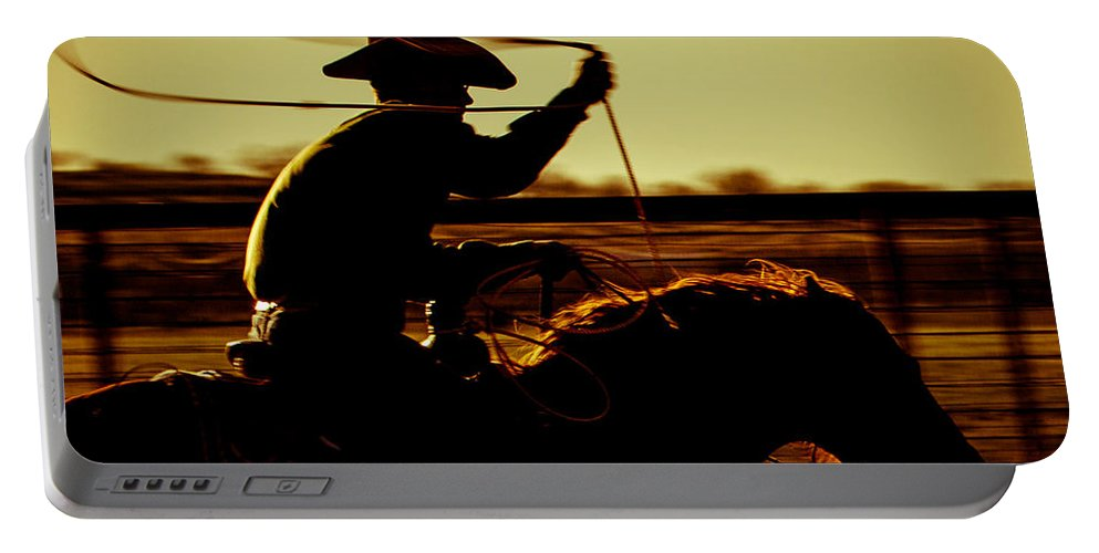 Cowboy Portable Battery Charger featuring the photograph Gettin' Left by Kelli Brown