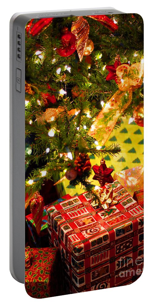 Christmas Portable Battery Charger featuring the photograph Gifts Under Christmas Tree by Elena Elisseeva