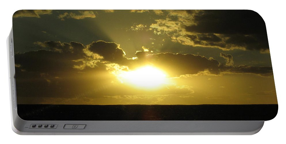 Sunset Portable Battery Charger featuring the photograph Gold Sunset by Dan McCafferty