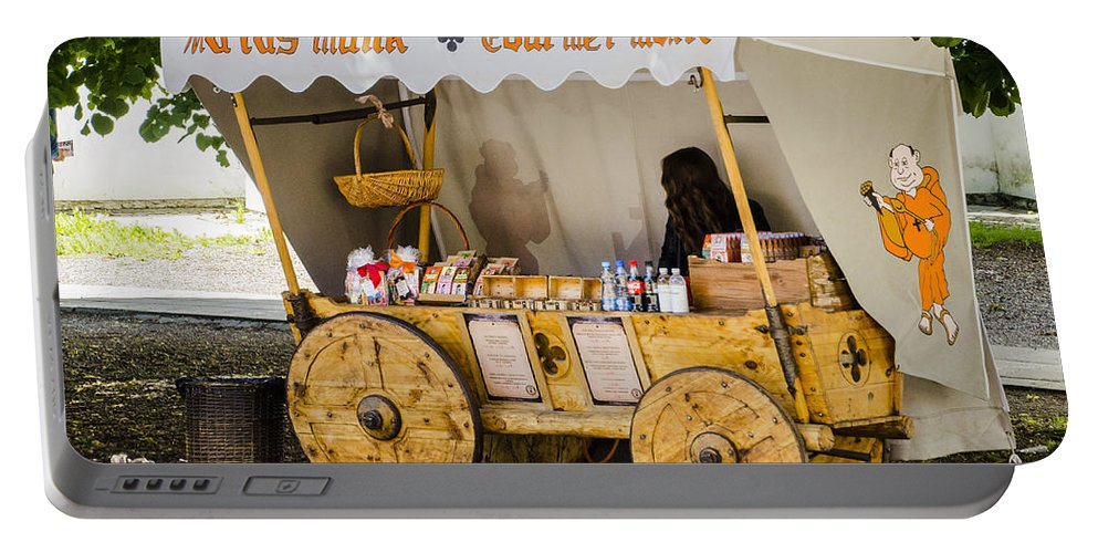 Estonia Portable Battery Charger featuring the photograph Gourmet Monk - Tallin Estonia by Jon Berghoff