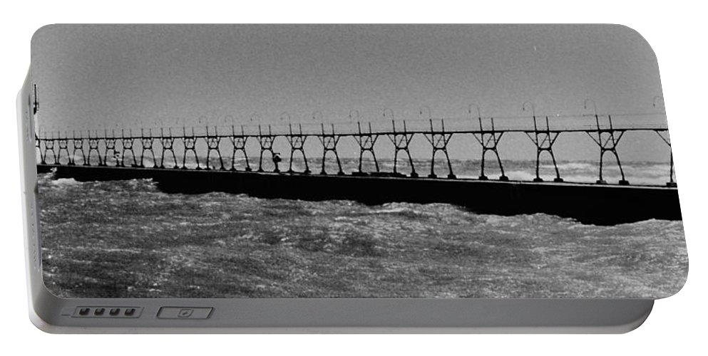 Portable Battery Charger featuring the photograph Grand Haven Light In Black And White by Daniel Thompson