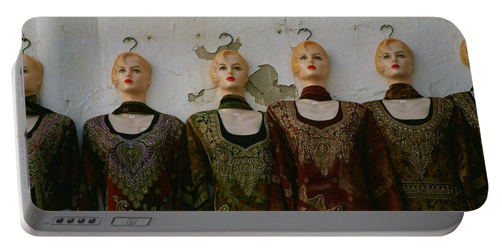 Photography Portable Battery Charger featuring the photograph Group Of Mannequins In A Market Stall by Panoramic Images