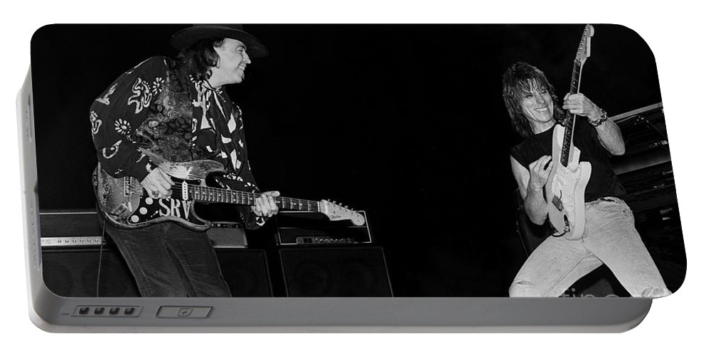 Portable Battery Charger featuring the photograph Guitarists Stevie Ray Vaughan W Jeff Beck by Concert Photos