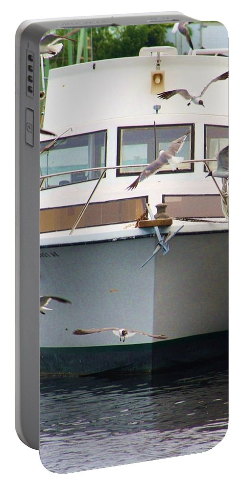 Florida Portable Battery Charger featuring the photograph Gulls And Boat by Chuck Hicks