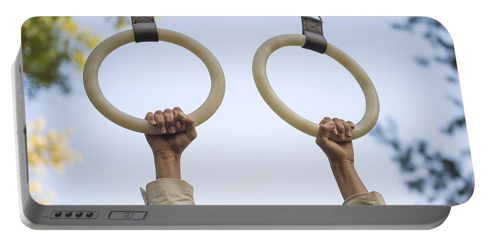 Hand Portable Battery Charger featuring the photograph Gymnastic Rings by Mats Silvan