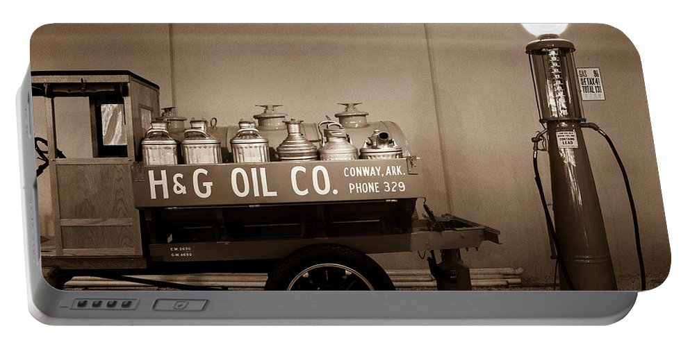 H&g Portable Battery Charger featuring the photograph H And G Oil Company In Sepia by Douglas Barnett