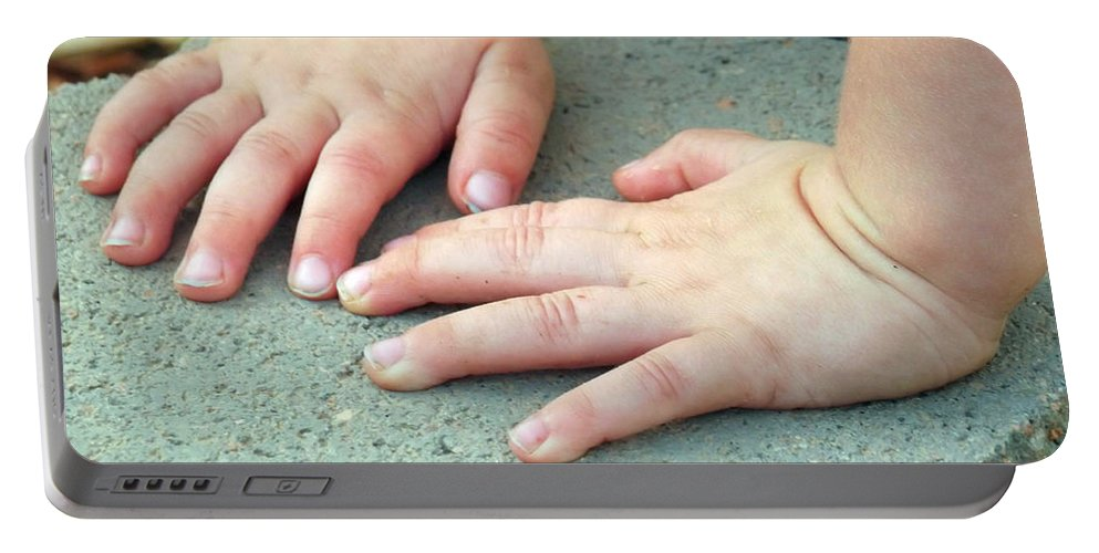 Baby Portable Battery Charger featuring the photograph Hands Of Our Future by Jennifer Lavigne