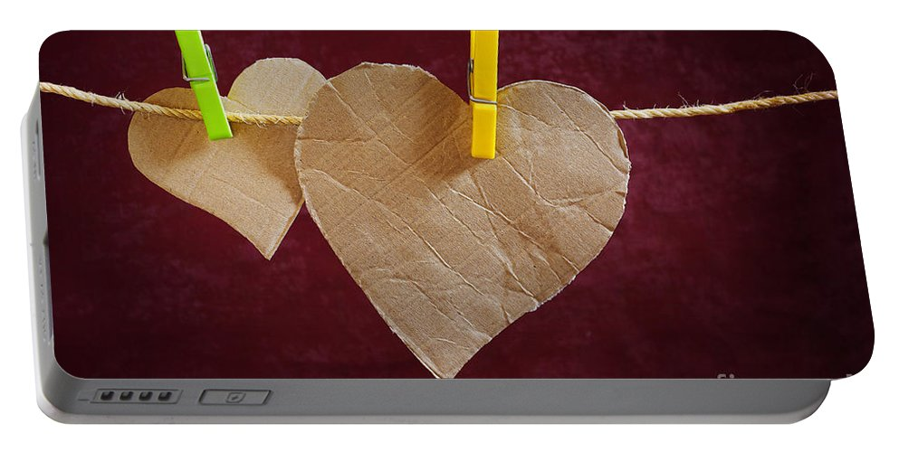 Aged Portable Battery Charger featuring the photograph Hanged Heart by Carlos Caetano