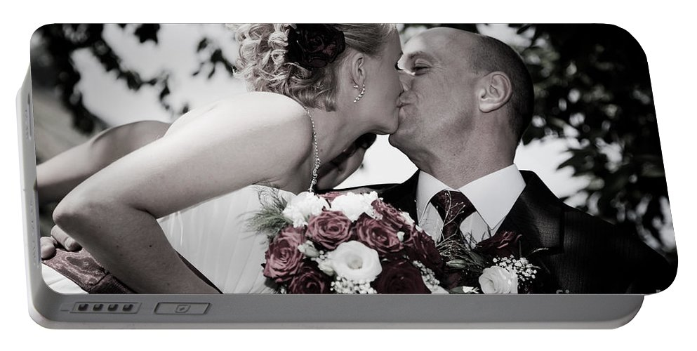 Bride Portable Battery Charger featuring the photograph Happy Bride And Groom Kissing by Michal Bednarek