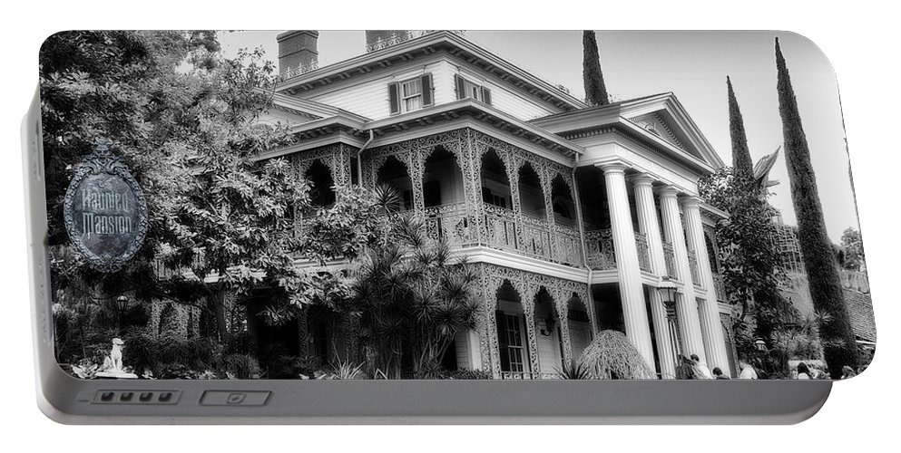 Disney Portable Battery Charger featuring the photograph Haunted Mansion New Orleans Disneyland Bw by Thomas Woolworth