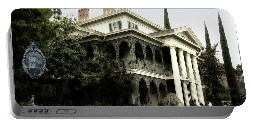 Disney Portable Battery Charger featuring the photograph Haunted Mansion New Orleans Disneyland by Thomas Woolworth