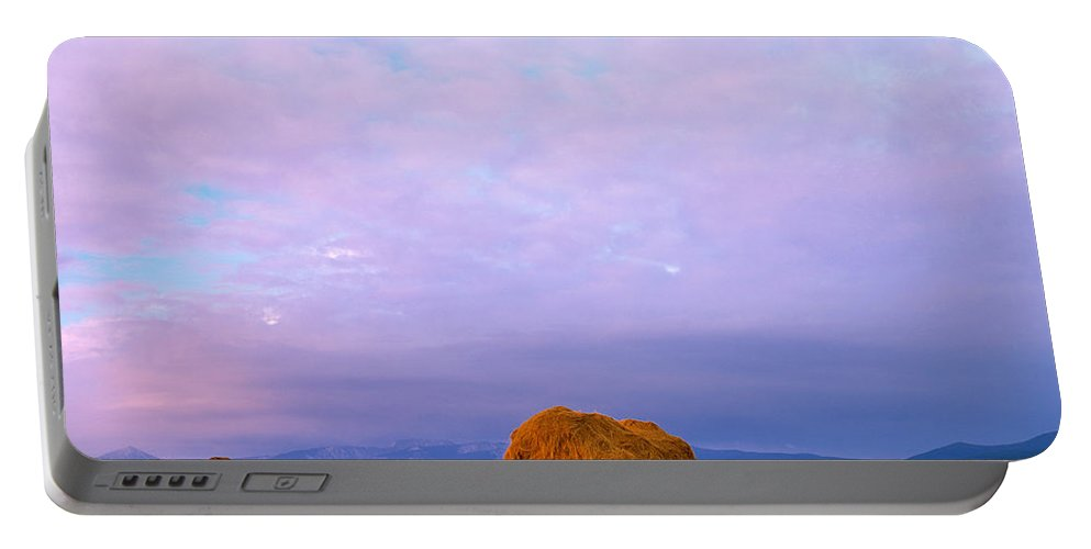 Big Hole Valley Portable Battery Charger featuring the photograph Hay Stacks by Leland D Howard