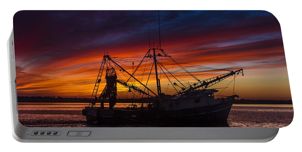 Boats Portable Battery Charger featuring the photograph Heading Home by Debra and Dave Vanderlaan