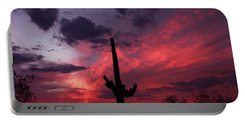 Heart Shaped Cloud Portable Battery Charger featuring the photograph Heart Of The Sunset by Laurie Larson