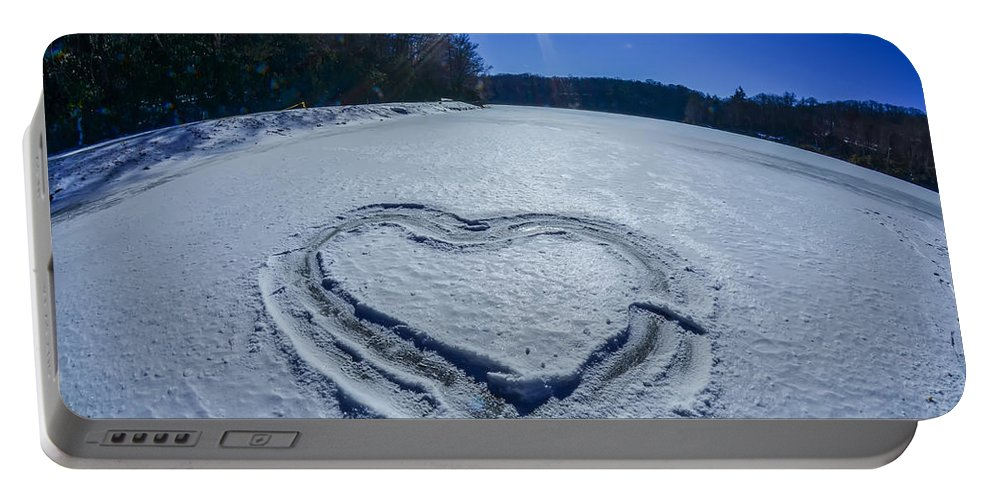 Ice Portable Battery Charger featuring the photograph Heart Outlined On Snow On Topw Of Frozen Lake by Alex Grichenko