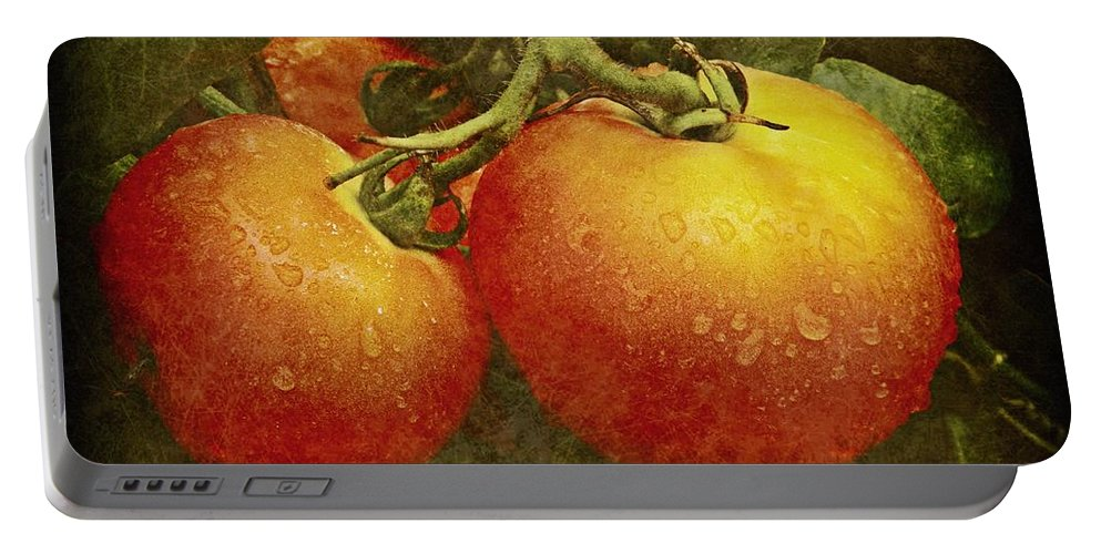 Amish Portable Battery Charger featuring the photograph Heirloom Tomatoes On The Vine by Chris Berry