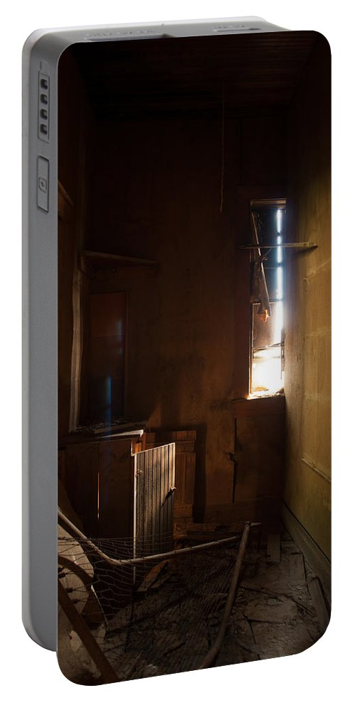 Montana Portable Battery Charger featuring the photograph Hidden In Shadow by Fran Riley