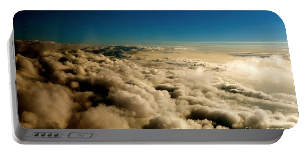 Clouds Portable Battery Charger featuring the photograph High Above by Jacqueline Athmann