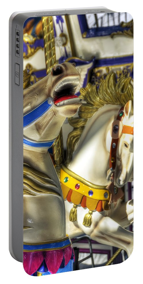 Carousel Portable Battery Charger featuring the photograph High And Boastful Neighs by Wayne Sherriff