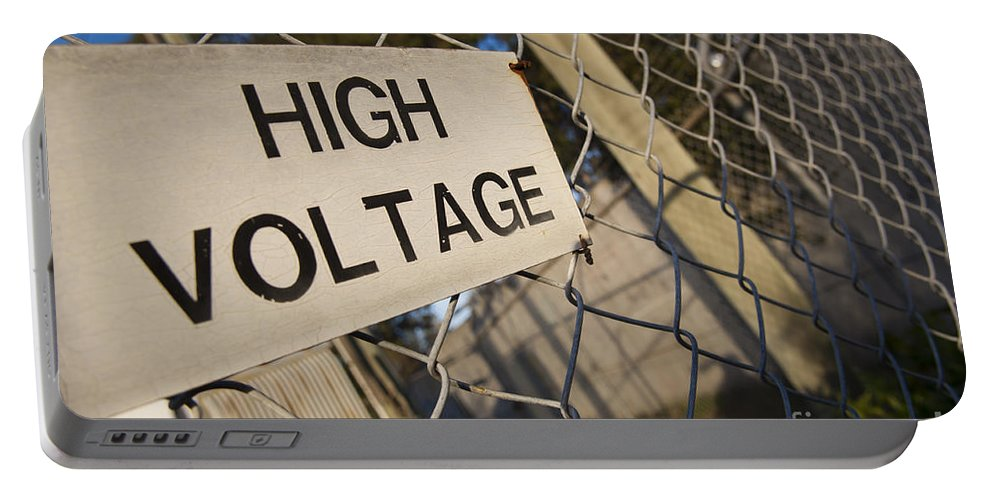 Background Portable Battery Charger featuring the photograph High Voltage by Tim Hester