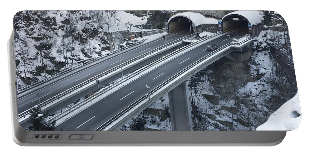 Highway Portable Battery Charger featuring the photograph Higway Tunnel With A Bridge by Mats Silvan