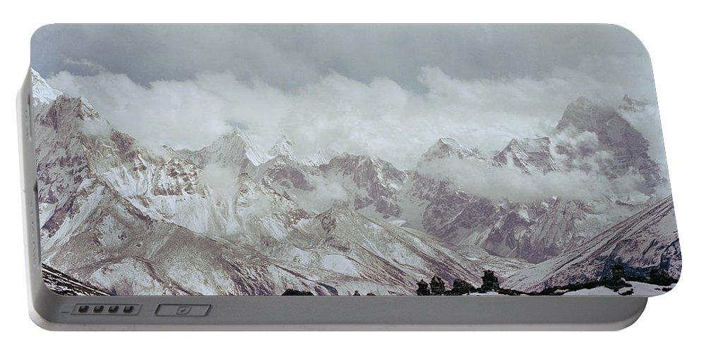 Himalayan Mountain Portable Battery Charger featuring the photograph Himalayan Sherpa Memorial by Shaun Higson