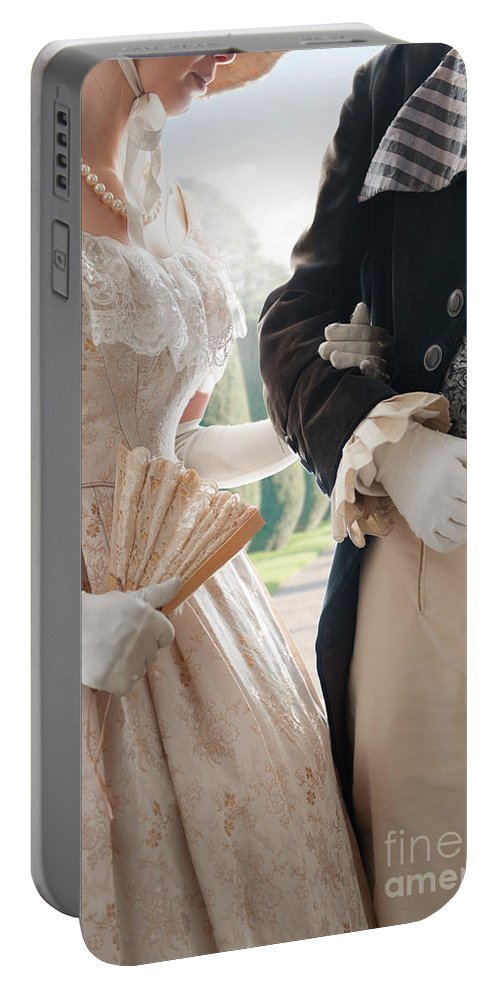 Regency Portable Battery Charger featuring the photograph Historical Couple Arm In Arm by Lee Avison