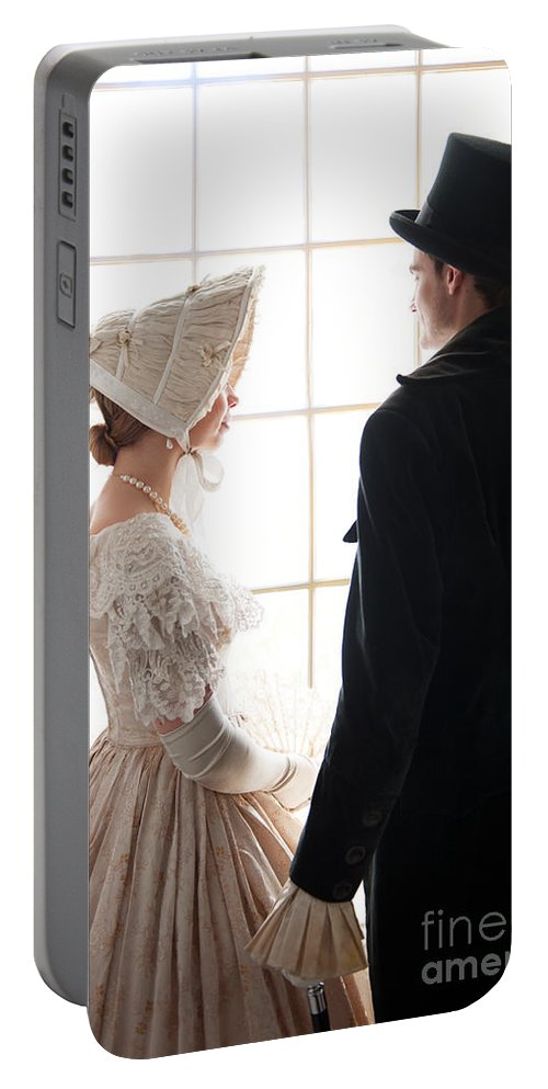 Victorian Portable Battery Charger featuring the photograph Historical Couple Standing By A Window by Lee Avison