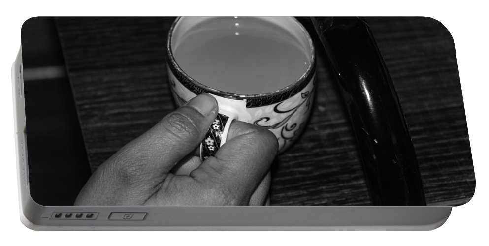 Canon 650d Portable Battery Charger featuring the photograph Holding A Full Cup Of Hot Tea by Ashish Agarwal