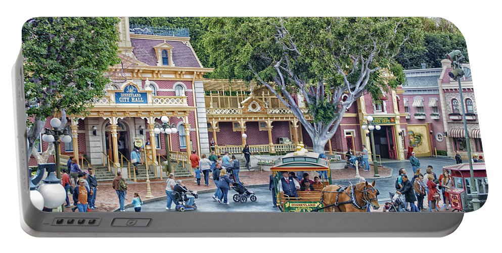 Disney Portable Battery Charger featuring the photograph Horse And Trolley Turning Main Street Disneyland 01 by Thomas Woolworth