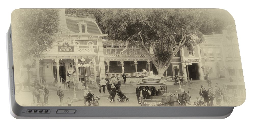 Disney Portable Battery Charger featuring the photograph Horse And Trolley Turning Main Street Disneyland Heirloom by Thomas Woolworth