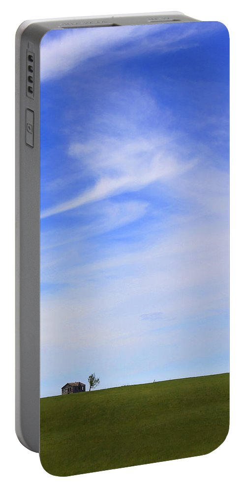Interesting Clouds Portable Battery Charger featuring the photograph House On The Hill by Mike McGlothlen