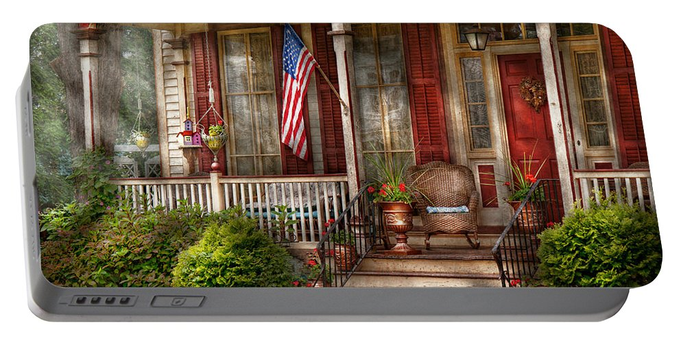 Victorian Portable Battery Charger featuring the photograph House - Porch - Belvidere Nj - A Classic American Home by Mike Savad