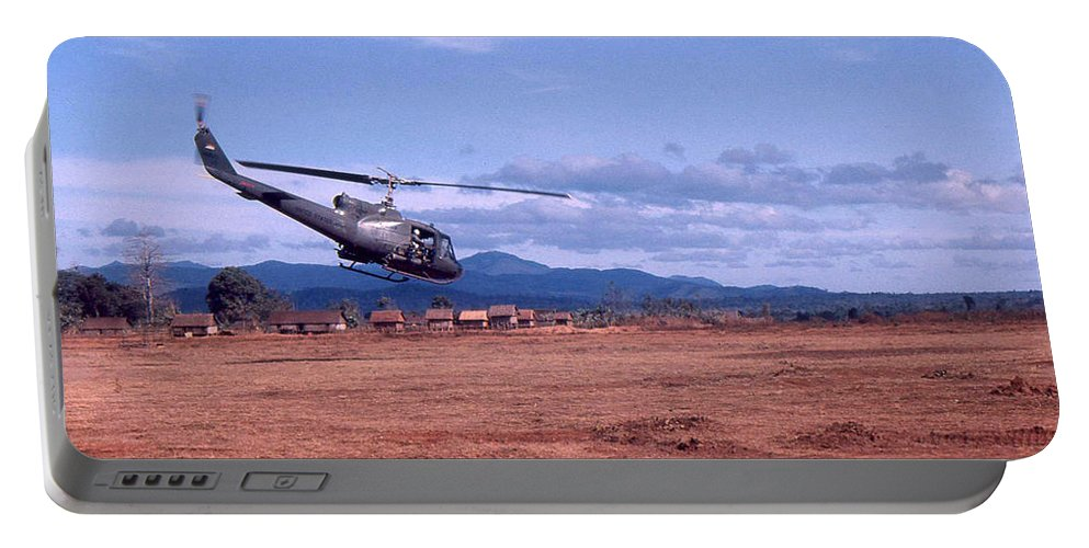 Uh-1 Helicopter Portable Battery Charger featuring the photograph Huey by Norman Johnson
