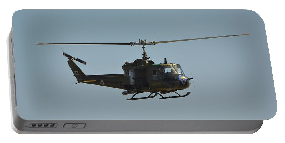 Bell Uh-1b Huey Portable Battery Charger featuring the photograph Huey by Tommy Anderson