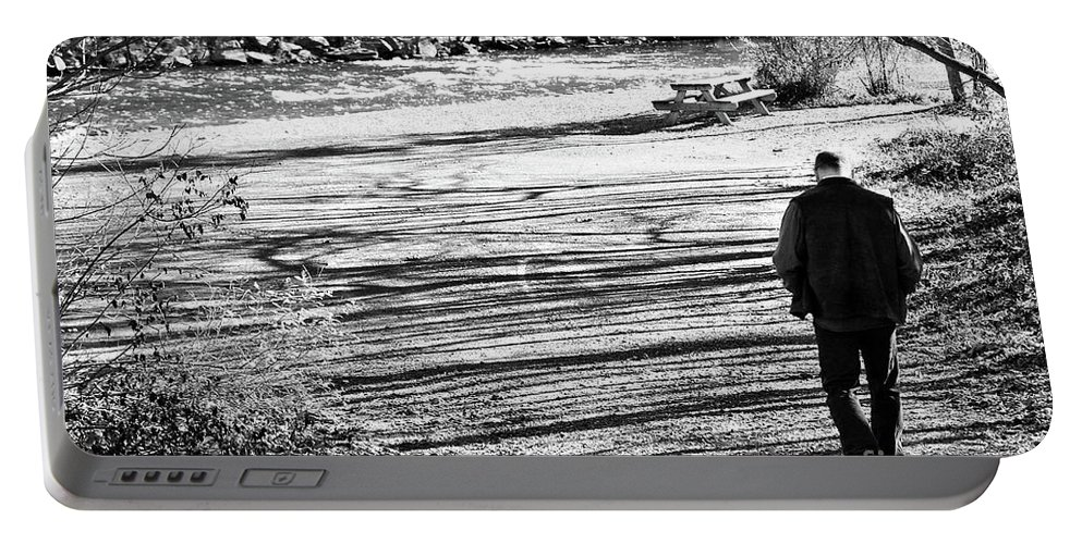 Person Portable Battery Charger featuring the photograph I Walk Alone by Lori Tambakis