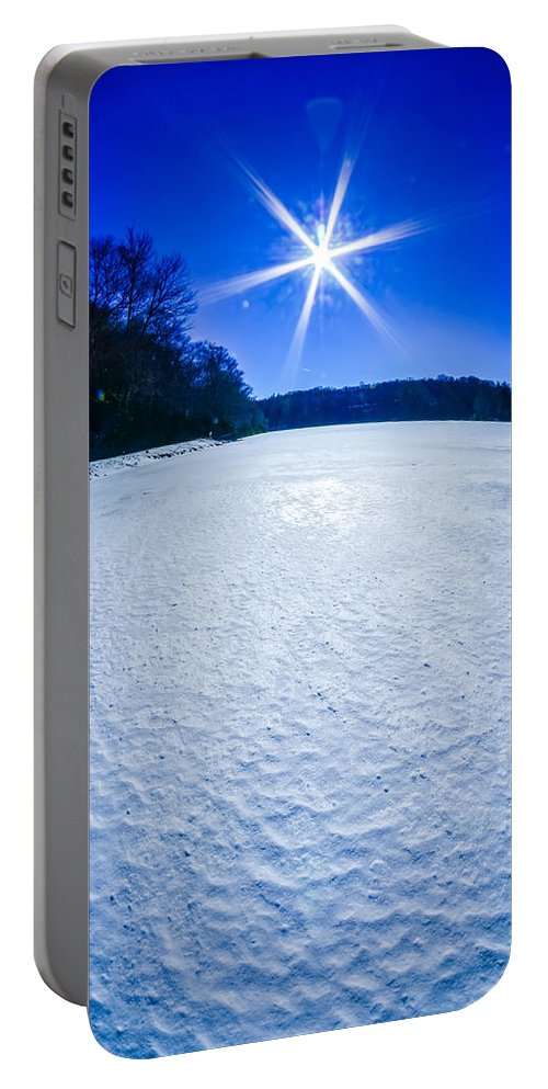 Ice Portable Battery Charger featuring the photograph Ice And Snow Frozen Over Lake On Sunny Day by Alex Grichenko
