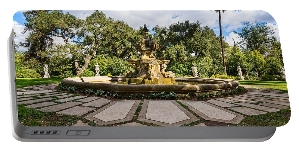 Rge Fountain Portable Battery Charger featuring the photograph Iconic Fountain by Jamie Pham