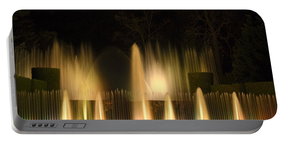 Illuminated Dancing Fountains Among Shrubbery Portable Battery Charger featuring the photograph Illuminated Dancing Fountains by Sally Weigand