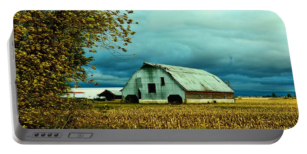 Arcitecture Portable Battery Charger featuring the photograph Impending Storm II by Debbie Portwood