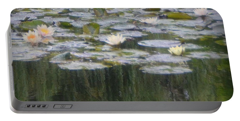 Monet Portable Battery Charger featuring the photograph Impressions Of Monet's Water Lilies by Carla Parris