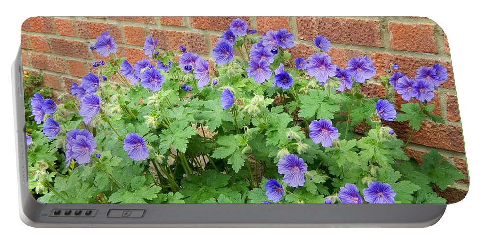 Floral Portable Battery Charger featuring the photograph In Neighbours Garden by Loreta Mickiene