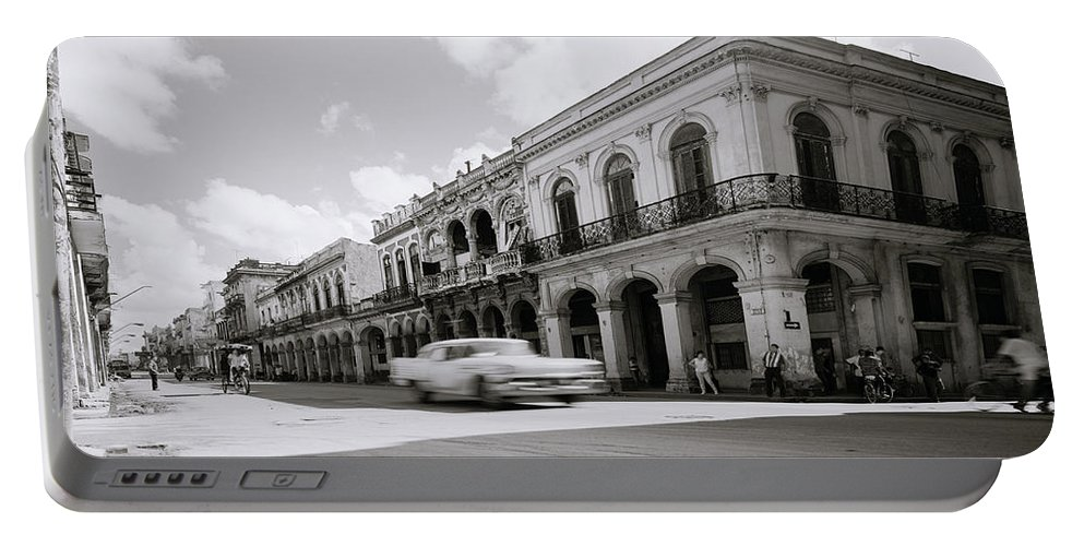 Havana Portable Battery Charger featuring the photograph The Streets Of Havana by Shaun Higson